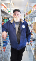 Manager of the Wilberforce Food Bank, Ken Mott has been busy stacking food on the shelves at the new food hub location in Highlands East. Located at 2249 Loop Road, the food bank has been open to the public since Jan. 6 and is already filled with jars of pasta sauce, tubs of peanut butter and frozen meals. ANGELICA INGRAM Staff