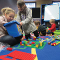 Event co-ordinator Louise Villeneuve speaks with parents about the cognitive and fine-motor benefits of Lego engineering at the Bancroft Public Library, as Kaitlyn and Clara get down to building. SARAH VANCE Special To This Week
