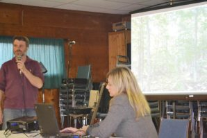 Ernie Demuth gives a presentation to members of the Bancroft Area Forest Industry Association on the ravages of Beech bark disease, as BAFIA VP Virgina DeCarle assists.