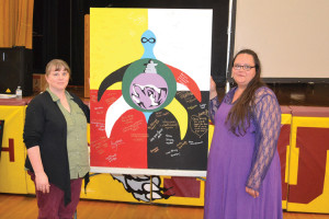 Teacher Heather Taylor and Marsha Depotier of the Metis Nation of Ontario show the banner of support from NHHS, which will be sent to the Attawapiskat community. TONY PEARSON Special to This Week