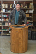 Don Zilstra shows off the Works of Wood organic rain barrel.