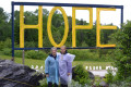 Exhausted and wet but pleased, Relay organizers Audrey Mackey and Flo Vandermeer pose under the Sign of Hope at the end of the event. This year, the rain held off until4 a.m.