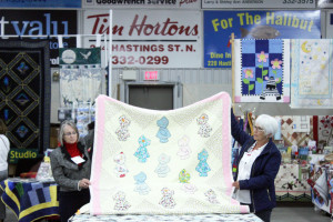 This year at the show there was a bed turning event where historical quilts were individually displayed with an accompanying story. Donna Ireland and Betty Stringer, below, are holding up one of 21 quilts submitted for the event.