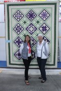 President chair of this year's quilt show Mary Kelly, far right, and treasurer Pat Anderton, stand in front of Patricia Liverseeds's beautiful quilt. Kelly said the show was very successful and received an overwhelmingly positive response from those who visited and stopped to chat.